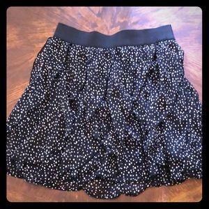 Maurice's small black ruffled skirt